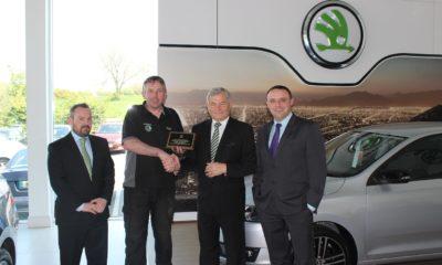 Liam Lynch makes a presentation fo Mike Murphy to celebrate Mike's quarter-century career milestone with Liam Lynch Motors Škoda, Farranfore.