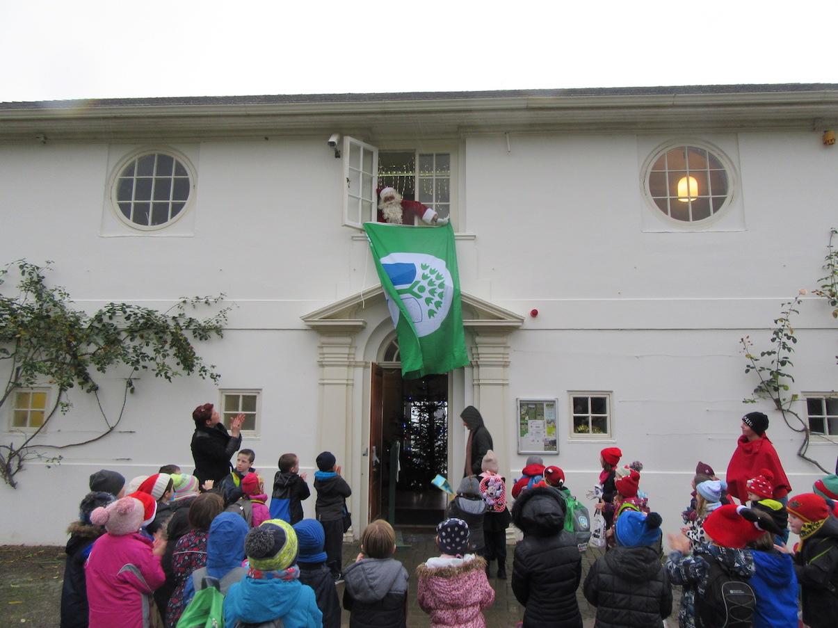 Santa raises the Green Flag at Killarney National Park Education Centre.